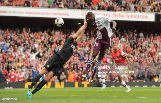 Aston Villa's Christian Benteke scores his side's equalising goal from header after his penalty is rebounded after Arsenal goalkeeper Wojciech...
