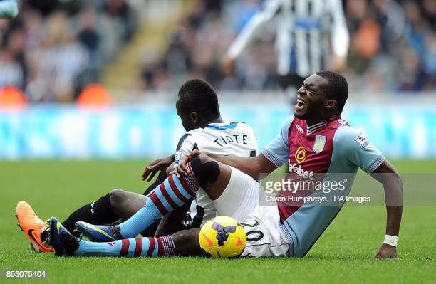 Aston Villa's Christian Benteke sits in pain after a challenge with Newcastle United's Cheick Tiote