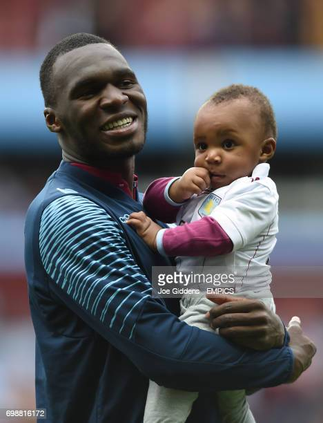 Aston Villa's Christian Benteke with his son during the lap of apreciation