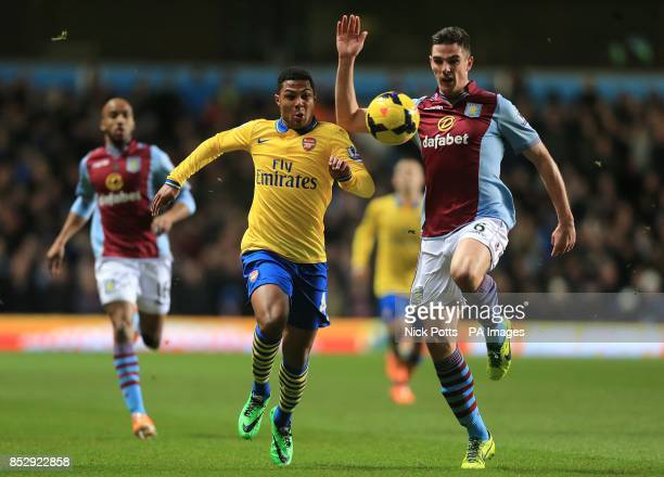 Aston Villa's Ciaran Clark and Arsenal's Serge Gnabry battle for the ball