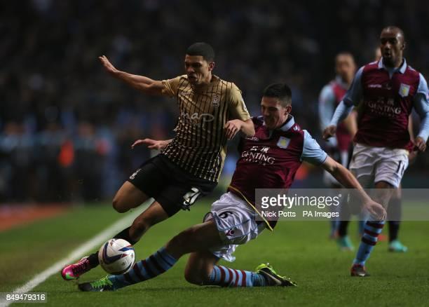 Aston Villa's Ciaran Clark and Bradford City's Nahki Wells battle for the ball