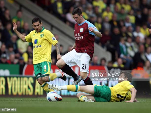 Aston Vill'as Ciaran Clark tussles with Norwich City's Jonathan Howson during the Barclays Premier League match at Carrow Road Norwich