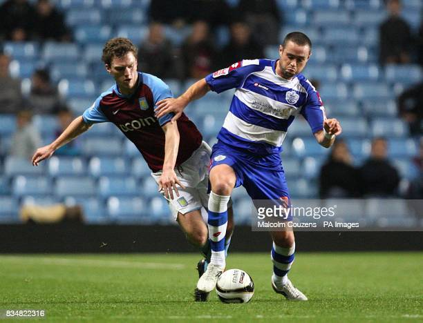 Aston Villa's Craig Gardner and Queens Park Rangers' Damien Delaney battle for the ball