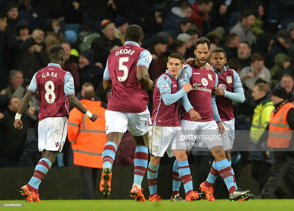 Aston Villa's English defender Joleon Lescott (2R) celebrates with teammates after scoring during the English Premier League football match between Aston Villa and Crystal Palace at Villa Park in Birmingham, central England on January 12, 2016. AFP PHOTO / PAUL ELLIS USE. No use with unauthorized audio, video, data, fixture lists, club/league logos or 'live' services. Online in-match use limited to 75 images, no video emulation. No use in betting, games or single club/league/player publications. / AFP / PAUL