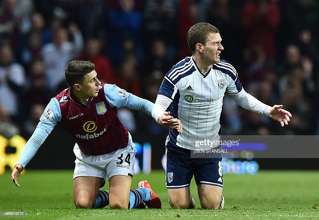 Aston Villa's English defender <a gi-track='captionPersonalityLinkClicked' href=/galleries/search?phrase=Matthew+Lowton&family=editorial&specificpeople=8309591 ng-click='$event.stopPropagation()'>Matthew Lowton</a> (L) and West Bromwich Albion's English midfielder <a gi-track='captionPersonalityLinkClicked' href=/galleries/search?phrase=Craig+Gardner&family=editorial&specificpeople=685283 ng-click='$event.stopPropagation()'>Craig Gardner</a> react during the FA Cup quarter-final match between Aston Villa and West Bromwich Albion at Villa Park in Birmingham, central England on March 7, 2015. Aston Villa won the game 2-0. AFP PHOTO / BEN STANSALL OR 'LIVE' SERVICES. ONLINE