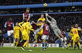 Aston Villas English defender Nathan Baker heads the ball but fails to score during the English Premier League football match between Aston Villa and...