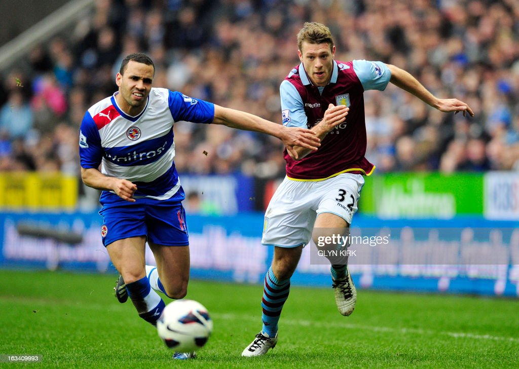"""Aston Villa's English midfielder Nathan Baker (R) vies with Reading's Welsh striker Hal Robson-Kanu (L) during the English Premier League football match between Reading and Aston Villa at the Madejski Stadium in Reading, Berkshire, on March 9, 2013. Aston Villa won 2-1. USE. No use with unauthorized audio, video, data, fixture lists, club/league logos or """"live"""" services. Online in-match use limited to 45 images, no video emulation. No use in betting, games or single club/league/player publications"""