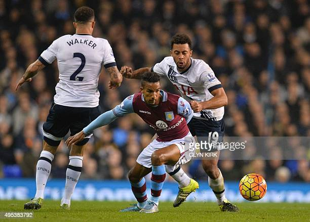Aston Villa's English midfielder Scott Sinclair vies with Tottenham Hotspur's Belgian midfielder Mousa Dembele during the English Premier League...