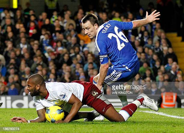 Aston Villa's English striker Darren Bent appeals for a penalty after a challenge from Chelsea's English defender John Terry during the English...