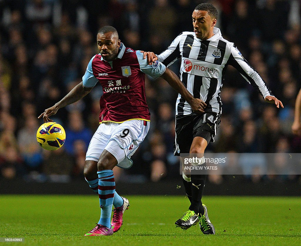 "Aston Villa's English striker Darren Bent (L) vies with Newcastle United's English defender James Perch (R) during the English Premier League football match between Aston Villa and Newcastle United at Villa Park in Birmingham, West Midlands, England on January 29, 2013. USE. No use with unauthorized audio, video, data, fixture lists, club/league logos or ""live"" services. Online in-match use limited to 45 images, no video emulation. No use in betting, games or single club/league/player publications."