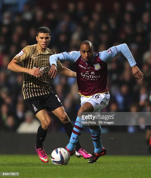 Aston Villa's Fabian Delph and Bradford City's Nahki Wells battle for the ball