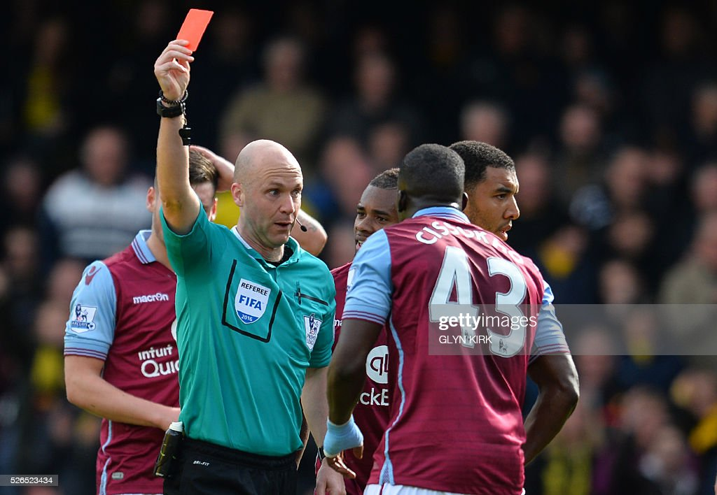 Aston Villa's French defender Aly Cissokho (R) receives a red card from referee Anthony Taylor during the English Premier League football match between Watford and Aston Villa at Vicarage Road Stadium in Watford, north of London on April 30, 2016. / AFP / GLYN KIRK / RESTRICTED TO EDITORIAL USE. No use with unauthorized audio, video, data, fixture lists, club/league logos or 'live' services. Online in-match use limited to 75 images, no video emulation. No use in betting, games or single club/league/player publications. /