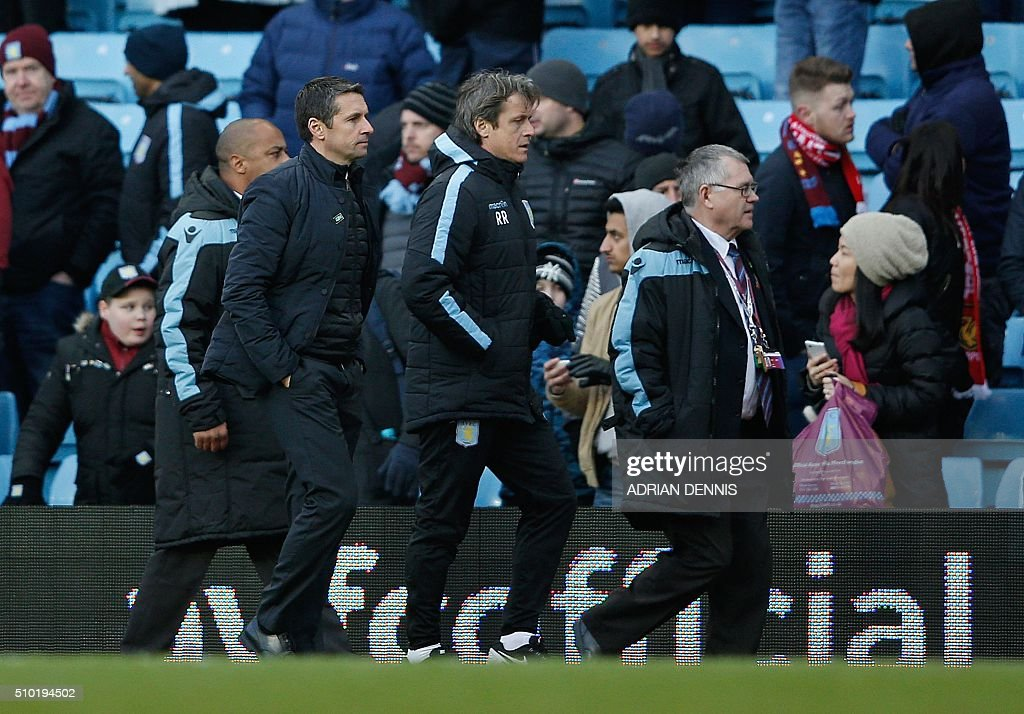 Aston Villa's French manager Remi Garde (2L) leaves the pitch following the English Premier League football match between Aston Villa and Liverpool at Villa Park in Birmingham, central England on February 14, 2016. Liverpool won the match 6-0. / AFP / ADRIAN DENNIS / RESTRICTED TO EDITORIAL USE. No use with unauthorized audio, video, data, fixture lists, club/league logos or 'live' services. Online in-match use limited to 75 images, no video emulation. No use in betting, games or single club/league/player publications. /