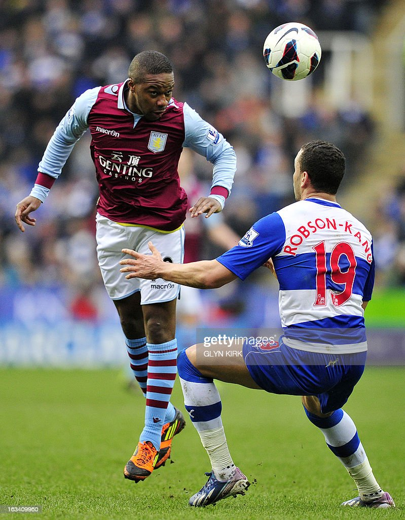 """Aston Villa's French midfielder Charles N'Zogbia (L) vies with Reading's Welsh striker Hal Robson-Kanu (R) during the English Premier League football match between Reading and Aston Villa at the Madejski Stadium in Reading, Berkshire, on March 9, 2013. Aston Villa won 2-1. USE. No use with unauthorized audio, video, data, fixture lists, club/league logos or """"live"""" services. Online in-match use limited to 45 images, no video emulation. No use in betting, games or single club/league/player publications"""