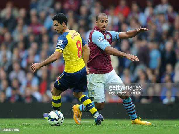 Aston Villa's Gabriel Agbonlahor and Arsenal's Mikel Arteta battle for the ball
