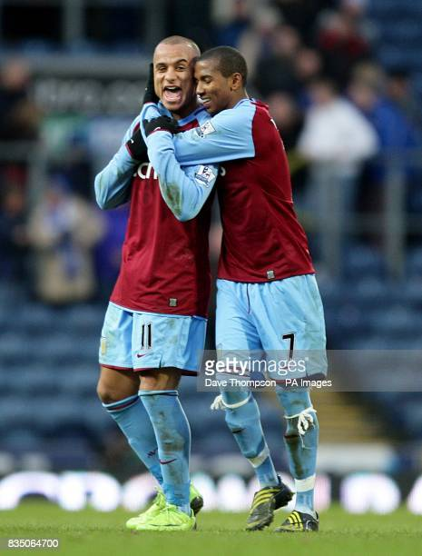 Aston Villa's Gabriel Agbonlahor and Ashley Young celebrate after the final whistle