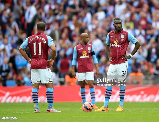 Aston Villa's Gabriel Agbonlahor and Aston Villa's Christian Benteke wait to restart the match after Arsenal's Per Mertesacker scores his side's...