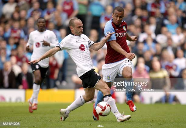 Aston Villa's Gabriel Agbonlahor and Fulham's Danny Murphy battle for the ball