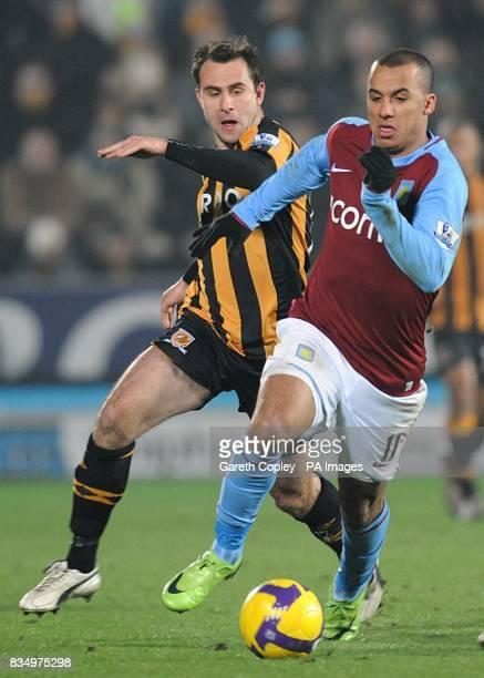 Aston Villa's Gabriel Agbonlahor and Hull City's Richard Garcia battle for the ball