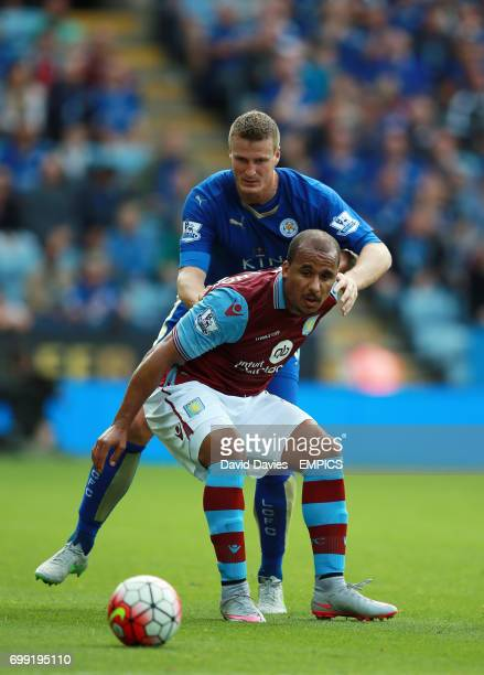 Aston Villa's Gabriel Agbonlahor and Leicester City's Robert Huth battle for the ball