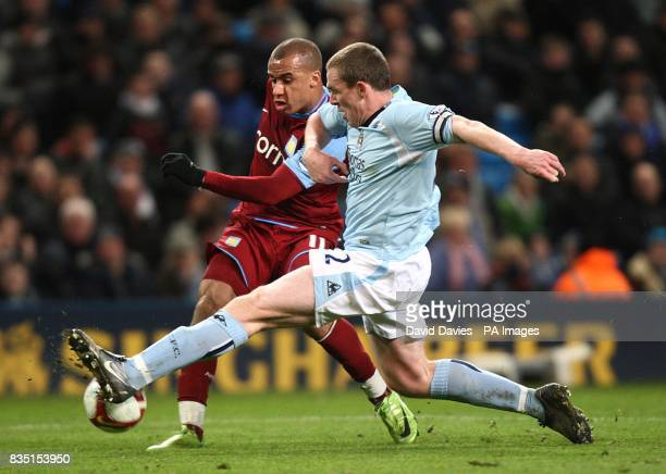 Aston Villa's Gabriel Agbonlahor and Manchester City's Richard Dunne battle for the ball