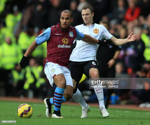 Aston Villa's Gabriel Agbonlahor and Manchester United's Jonny Evans battles for the ball