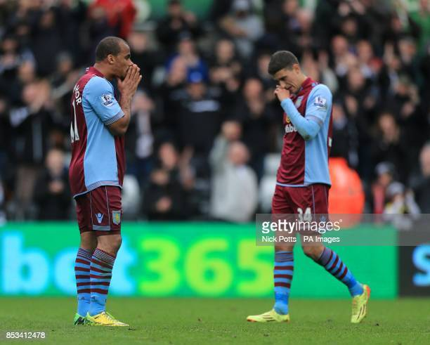 Aston Villa's Gabriel Agbonlahor and Matthew Lowton appear dejected