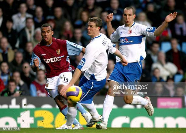 Aston Villa's Gabriel Agbonlahor and Middlesbrough's Emanuel Pogatetz and Robert Huth