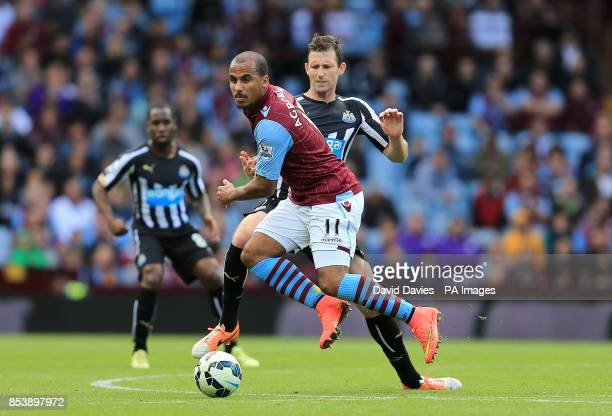 Aston Villa's Gabriel Agbonlahor and Newcastle United's Mike Williamson battle for the ball during the Barclays Premier League match at Villa Park...