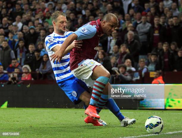 Aston Villa's Gabriel Agbonlahor and Queens Park Rangers' Clint Hill battle for the ball