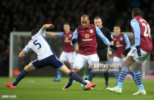 Aston Villa's Gabriel Agbonlahor and West Bromwich Albion's Claudio Yacob battle for the ball