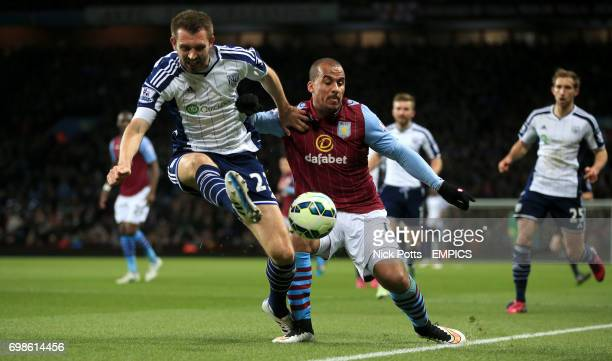 Aston Villa's Gabriel Agbonlahor and West Bromwich Albion's Gareth McAuley battle for the ball