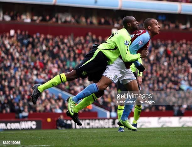 Aston Villa's Gabriel Agbonlahor and Wigan Athletic's Titus Bramble during the Barclays Premier League match at Villa Park Birmingham