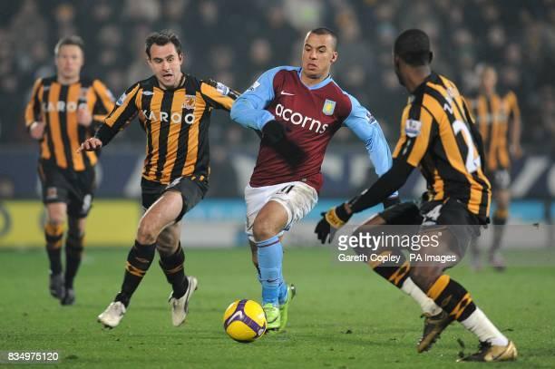 Aston Villa's Gabriel Agbonlahor battles for the ball with Hull City's Kamil Zayatte and Richard Garcia