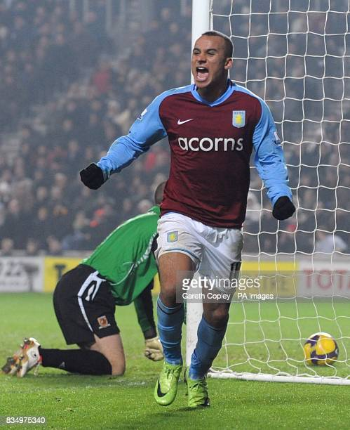 Aston Villa's Gabriel Agbonlahor celebrates after Hull City's Kamil Zayatte scores on own goal to win the game for Villa
