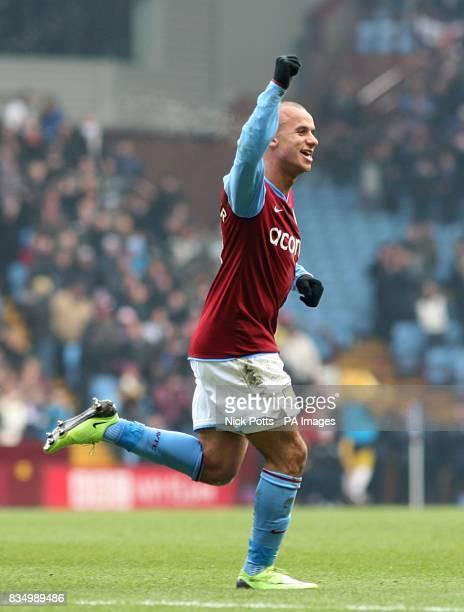 Aston Villa's Gabriel Agbonlahor celebrates after West Bromwich Albion goalkeeper Scott Carson scores an own goal