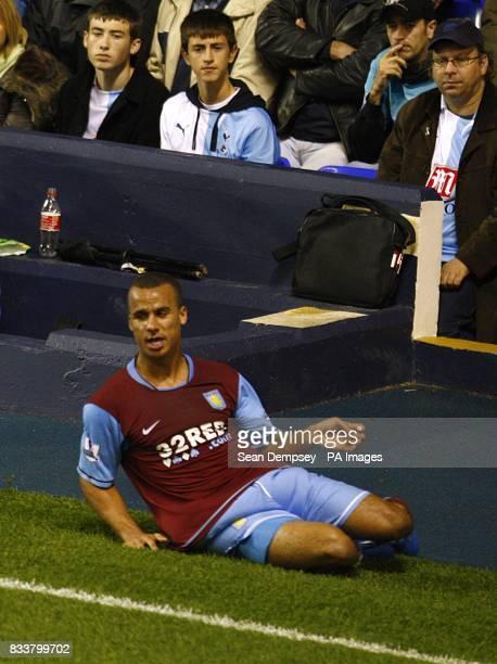 Aston Villa's Gabriel Agbonlahor celebrates his goal as Tottenham Hotspur fans look on dejected