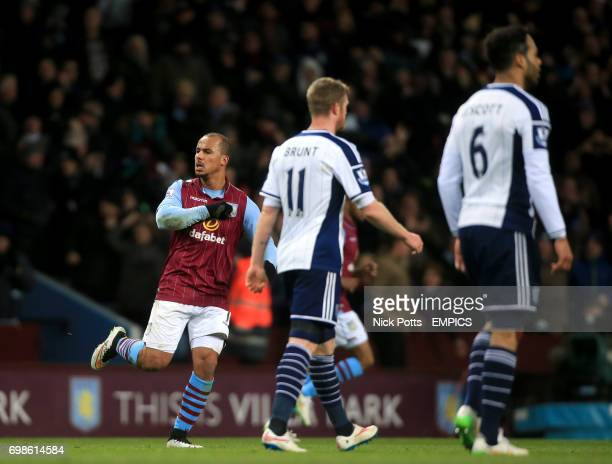 Aston Villa's Gabriel Agbonlahor celebrates scoring his side's first goal of the game as West Bromwich Albion's Chris Brunt and Joleon Lescott walk...