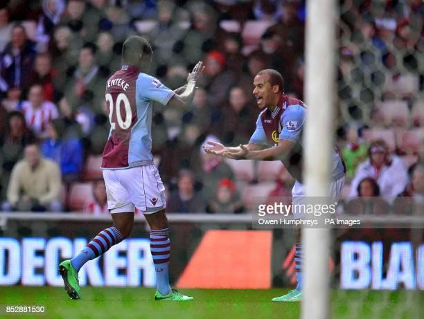 Aston Villa's Gabriel Agbonlahor celebrates with his teammate Christian Benteke after scoring his team's opening goal