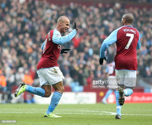 Aston Villa's Gabriel Agbonlahor celebrates with teammate Ashley Young after West Bromwich Albion goalkeeper Scott Carson scores an own goal