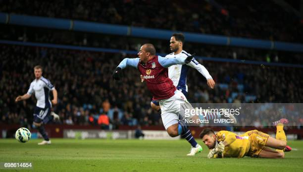 Aston Villa's Gabriel Agbonlahor goes round West Bromwich Albion goalkeeper Ben Foster but the ball is cleared off the line by Joleon Lescott
