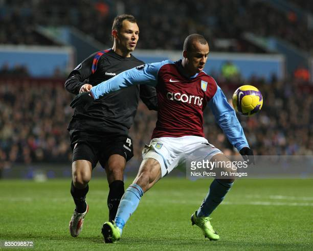 Aston Villa's Gabriel Agbonlahor holds off a challenge by CSKA Moscow's Sergei Ignashevich
