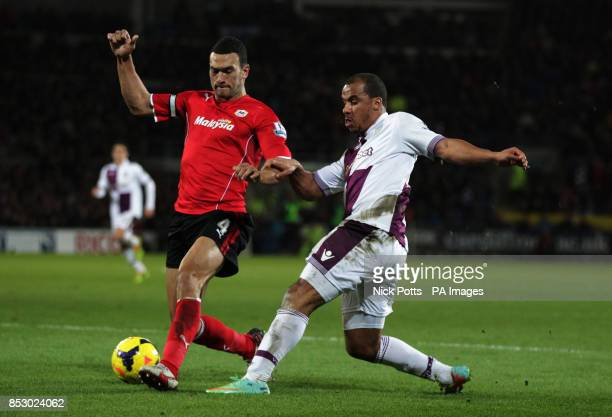 Aston Villa's Gabriel Agbonlahor is challenged by Cardiff City's Steven Caulker during the Barclays Premier League match at the Cardiff City Stadium...
