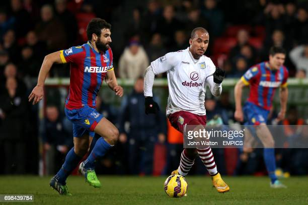 Aston Villa's Gabriel Agbonlahor is chased by Crystal Palace's Mile Jedinak