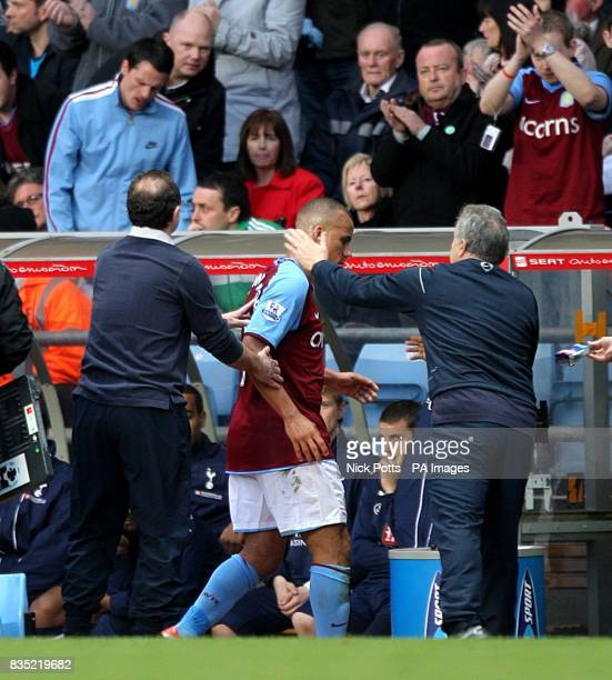 Aston Villa's Gabriel Agbonlahor is congratulated on his performance by manager Martin O'Neill and assistant manager John Robertson as he is...