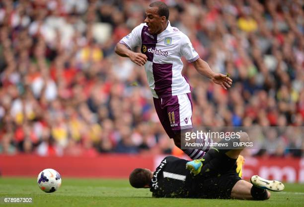 Aston Villa's Gabriel Agbonlahor is fouled by Arsenal goalkeeper Wojciech Szczesny leading to a penalty