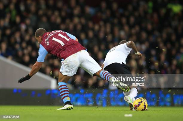 Aston Villa's Gabriel Agbonlahor is shown a red card by referee Mr Lee Mason after this challenge on Manchester United's Ashley Young