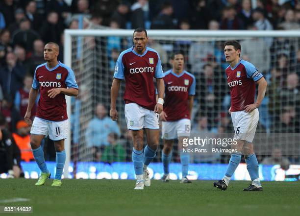 Aston Villa's Gabriel Agbonlahor John Carew Curtis Davies and Gareth Barry stand dejected after Stoke City equalise