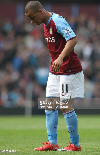 Aston Villa's Gabriel Agbonlahor limps on the pitch following an injury