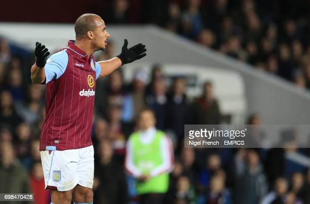 Aston Villa's Gabriel Agbonlahor protests after being shown a red card against Manchester United